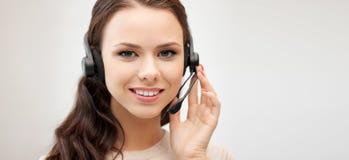 Friendly female helpline operator with headphones Stock Images