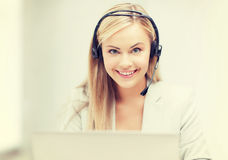Friendly female helpline operator with laptop Stock Photos