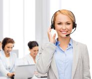 Friendly female helpline operator at office Stock Photos