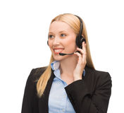 Friendly female helpline operator Stock Image