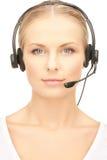 Friendly female helpline operator Stock Photo