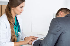 Friendly female medicine doctor's holding male patient's hand Stock Photo
