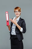 Friendly female office worker showing a folder Stock Images