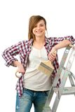 Friendly female painter with paint brush. Royalty Free Stock Image