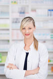 Friendly female pharmacist with crossed arms Royalty Free Stock Images