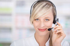Friendly female pharmacist with headsets royalty free stock photo