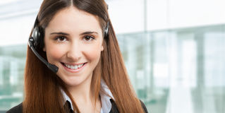 Smiling female phone operator Royalty Free Stock Photos