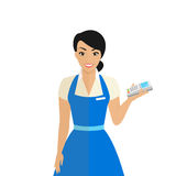 Friendly female shop assistant holding payment terminal in her hand Stock Photos
