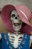 Friendly female skeleton waves hello. stock images