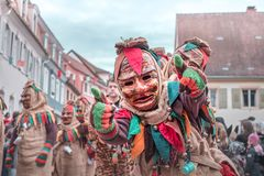 Friendly figure raises both thumbs up. Street carnival in southern Germany - Black Forest royalty free stock images