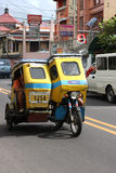 Friendly Filipino Motor Tricycle Driver. A Filipino man in Naga City, Philippines enjoys everyday life as a tricycle driver. Tricycles are one of the most Stock Photography