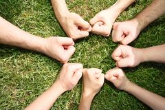 Friendly fists in a circle Stock Image
