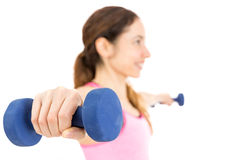 Friendly fitness woman holding dumbbells with both arms Stock Image