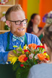 Friendly Flower Shop Owner and Customer Stock Photography
