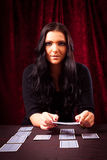 Friendly Fortune Teller With Cards Royalty Free Stock Photography