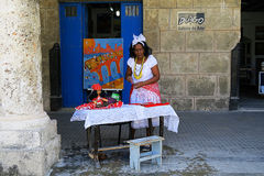 A friendly fortune teller in Havana. Cuba, Havana - 07 April, 2016: a friendly cheerful fortune teller inviting to tell the destiny to the passerby, tempting and Royalty Free Stock Images