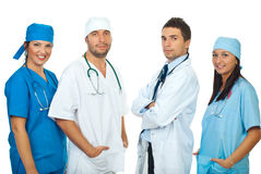 Friendly four doctors in a row Stock Photo