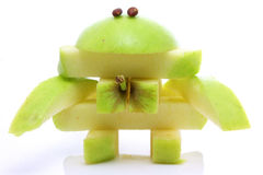 Friendly fruit monster. Friendly apple monster made from one whole apple royalty free stock photography