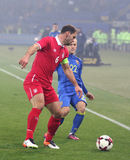Friendly game Ukraine v Serbia in Kharkiv. Kharkiv, Ukraine - November 15, 2016: Branislav Ivanovic of Serbia in Red controls a ball during Friendly match stock photography