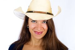 Friendly girl in a cowboy hat Stock Images