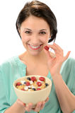 Friendly girl posing with cereal bowl Stock Image