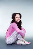 Friendly girl in pyjamas Royalty Free Stock Photos