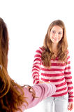 Friendly Girls Shaking Hands Stock Images