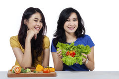 Friendly girls with vegetables salad Royalty Free Stock Images
