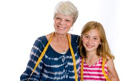 Friendly Grandma and Child with measuring tape Stock Photos