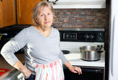 Friendly grandmother cooking Stock Photo