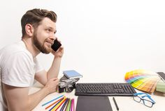 Friendly graphic designer talking with client. On the phone clean copy space background stock photos