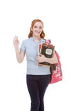 Friendly greeting Caucasian college student. Education series - Friendly Caucasian female high school student with backpack and composition book greeting you Stock Images