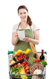 Friendly grocery store assistant Royalty Free Stock Images