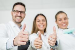 Friendly group of doctors with thumbs up Royalty Free Stock Photos