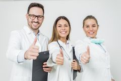 Friendly group of doctors with thumbs up Stock Photos