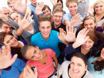 Friendly group of people waving to you Stock Photos