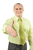Friendly handshake. Friendly businessman offering handshake, isolated on white Stock Photos