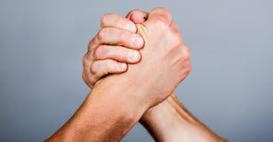 Friendly handshake, friends greeting, teamwork, friendship. Handshake, arms, friendship. Hand, rivalry, vs, challenge stock photography