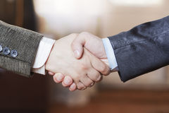 Friendly handshake. A friendly handshake two business partners in the office Royalty Free Stock Photo