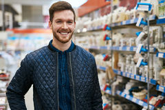 Friendly handsome man in a hardware store Royalty Free Stock Photography