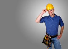 Friendly handy man portrait background. Isolated standing young worker with space for text Royalty Free Stock Image