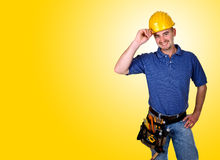Friendly handy man portrait background. Standing young worker with space for text Royalty Free Stock Photography