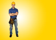 Friendly handy man portrait background. Standing young worker with space for text Royalty Free Stock Image