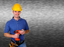 Friendly handy man portrait background. Isolated standing young worker with space for text brushed metal background Royalty Free Stock Photos