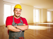 Friendly handyman in new house Royalty Free Stock Image