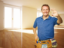 Friendly handyman in new house Royalty Free Stock Photos