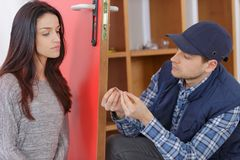 Friendly handyman visiting female client to help at home. Handyman stock photos