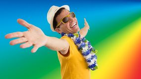 Friendly and happy man is welcoming. He is on his feet. Isolated. Carnival. Nice man is welcoming. Brazilian inviting. He is wearing sunglasses and hat. Flower Royalty Free Stock Photography