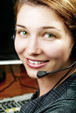 Friendly and happy service customer female worker. Friendly and happy service customer worker with headset Stock Images