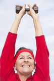 Friendly healthy mature woman exercising Royalty Free Stock Image